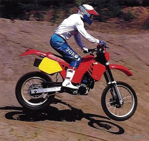 Red Husaberg Prototype. Note the big exhaust end (Husqvarana carried two silencers and some factory riders replaced or rerouted them to one unique end). This preproduction unit used Öhlins front forks, which never made it to the final design. And this plastic design is different from final production units. Rider: Stefan Elvin. Photographer: Mats Burman.