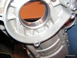 Ben Ballard (JBS Racing, United Kingdom) has been racing MX sidecars and by machining out the mains and putting a steel shouldered insert in he can control the rigidity and the fit of the bearings. Note that the bearings are fed in from outside the cases and then an internal nut is used to hold them down and in.